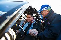 Feb 25, 2018; Chandler, AZ, USA; NHRA super gas driver Clint Fishel prays with RFC chaplain Jim Jack during the Arizona Nationals at Wild Horse Pass Motorsports Park. Mandatory Credit: Mark J. Rebilas-USA TODAY Sports