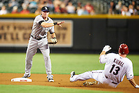 Colorado Rockies second baseman Josh Rutledge #14 attempts to turn a double play as Jason Kubel #13 slides in during a National League regular season game against the Arizona Diamondbacks at Chase Field on October 2, 2012 in Phoenix, Arizona. Arizona defeated Colorado 5-3. (Mike Janes/Four Seam Images)