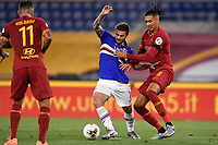 Karol Linetty of UC Sampdoria and Chris Smalling of AS Roma compete for the ball during the Serie A football match between AS Roma and UC Sampdoria at Olimpico stadium in Rome ( Italy ), June 24th, 2020. Play resumes behind closed doors following the outbreak of the coronavirus disease. AS Roma won 2-1 over UC Sampdoria. <br /> Photo Andrea Staccioli / Insidefoto