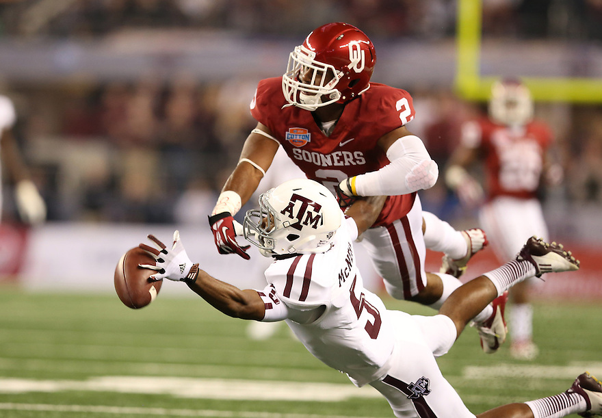 Jan 4, 2013; Arlington, TX, USA; Oklahoma Sooners defensive back Julian Wilson (2) defends a pass against the Texas A&M Aggies wide receiver Kendrick McNeal (5) during the Cotton Bowl at Cowboys Stadium.  Mandatory Credit: Tim Heitman-USA TODAY Sports
