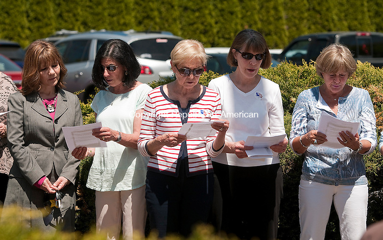 SOUTHBURY, CT--050715JS08-  Local residents read prayers for the nation during a gathering for National Day of Prayer Thursday at Southbury Town Hall.<br /> Jim Shannon Republican-American