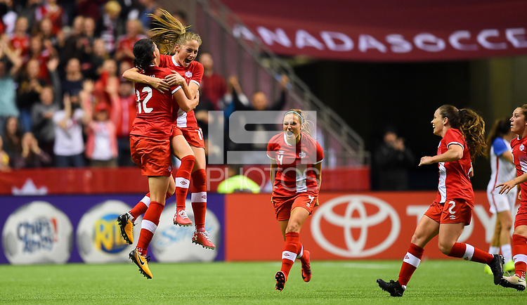 Vancouver, Canada - Thursday November 09, 2017: Christine Sinclair and Jessie Fleming celebrate during an International friendly match between the Women's National teams of the United States (USA) and Canada (CAN) at BC Place.