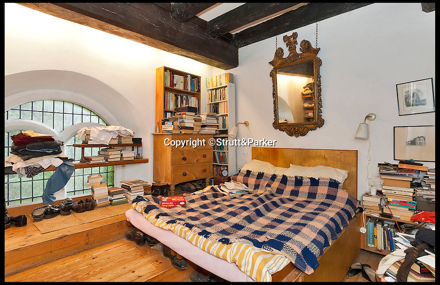 BNPS.co.uk (01202 558833)<br /> Pic: Strutt&amp;Parker/BNPS<br /> <br /> *Please use full byline*<br /> <br /> The maisonette bedroom.<br /> <br /> The owner of this converted church will be praying that a still in use graveyard won't put people off snapping up his unusual home.<br /> <br /> Old All Saints Church dates from the early 16th century with additions and renovations added later, but the churchyard around it is open to the public and still has one or two burials a year.<br /> <br /> The quirky home, which is Grade II* listed and almost 1,300 sq ft, consists of a kitchen and bathroom in the chapel, the nave and chancel have been converted to create a living, dining and study areas and a mezzanine floor was put in to create a bedroom.<br /> <br /> The current owner bought it as a derelict church in the 1970s and got planning permission to turn it into a home. He has lived there since but, following the death of his partner, decided to downsize and sell this unusual property.<br /> <br /> Sharnie Rogers from Strutt &amp; Parker, who are selling the property, said it still has all the characteristics of a church and there is still potential for more conversion to be done.