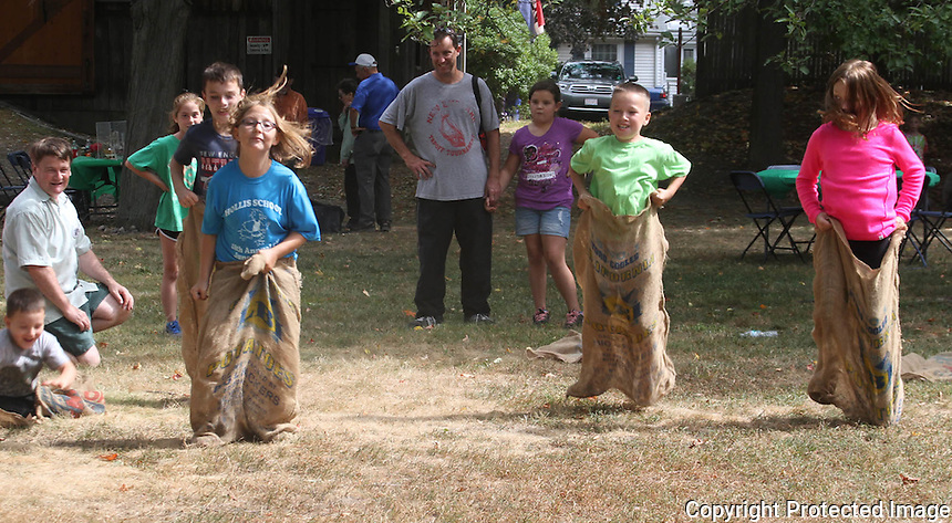 Kids competes in a sack race at the Braintree Historical Society's annual Heritage Day, at the Thayer House and Museum on Sunday September 21 2014.(Photo by Gary Wilcox)