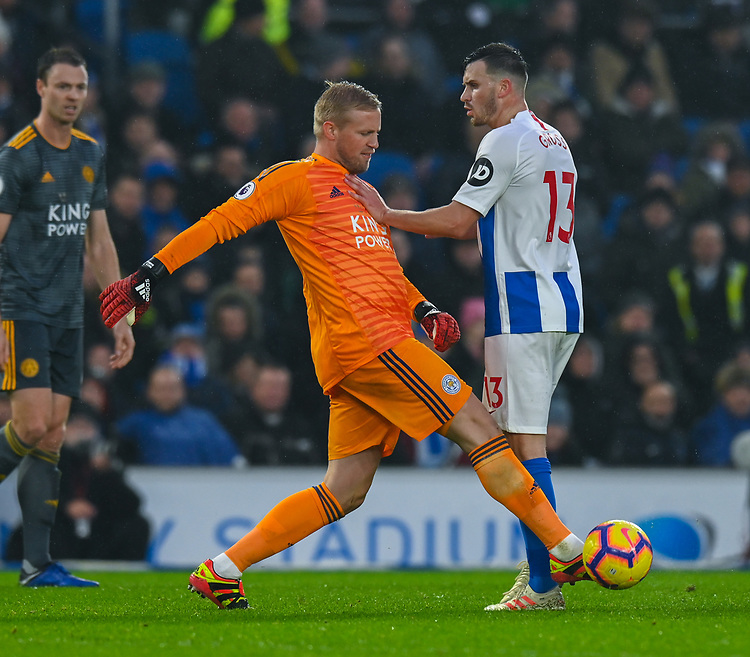 Leicester City's Kasper Schmeichel (left)  has a run in with Brighton & Hove Albion's Pascal Gross (right) <br /> <br /> Photographer David Horton/CameraSport<br /> <br /> The Premier League - Brighton and Hove Albion v Leicester City - Saturday 24th November 2018 - The Amex Stadium - Brighton<br /> <br /> World Copyright © 2018 CameraSport. All rights reserved. 43 Linden Ave. Countesthorpe. Leicester. England. LE8 5PG - Tel: +44 (0) 116 277 4147 - admin@camerasport.com - www.camerasport.com
