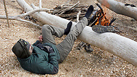 NWA Democrat-Gazette/DAVID GOTTSCHALK Greg Adams warms his feet Tuesday, February 6, 2018, at a campfire during a lunch break on the bank of the Meramec River. Eight paddlers from the Fayetteville area spent February 2-10, 2018 floating 46 miles of the spring fed river in Missouri.
