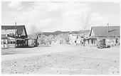 Looking down the street in Cimarron.  Gas station &amp; garage (Phillips 66) is on left and stores are on right.<br /> Cimarron, NM  Taken by Frasher, - ca 1935
