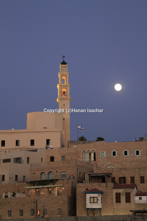 Israel, Tel Aviv-Yafo, a moonrise over the Franciscan St. Peter's Church in Old Jaffa