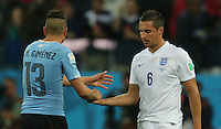 Dejected  Phil Jagielka shakes hands with Jose Gimenez after final Whistle