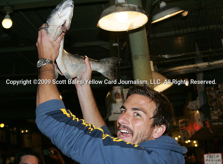 20 November 2009: Alan Gordon. Major League Soccer players Alan Gordon of the Los Angeles Galaxy and Chris Seitz of Real Salt Lake took part in a fish toss at Pike Place Market in Seattle, WA as part of the Major League Soccer MLS Cup weekend activities.