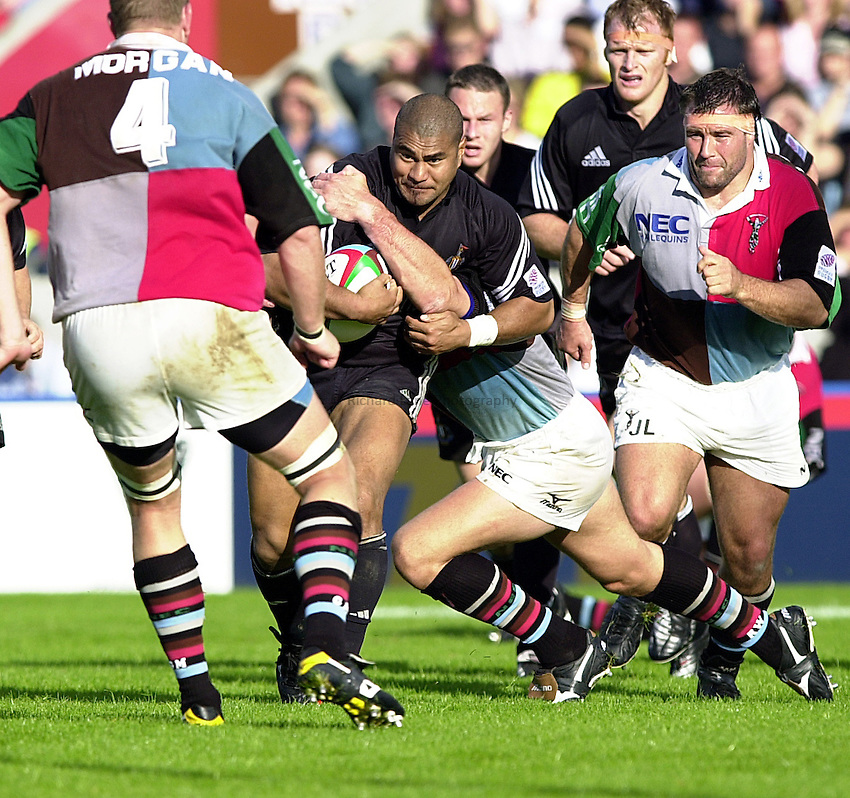 Photo Richard Lane..Harlequins v Newcastle.Zurich Premiership .Twickenham. 30.09.2000.Inga Tuigamala beligerantley runs at the Quins as Jason Leanard plays catch up and Garrick Morgan waits next in line.