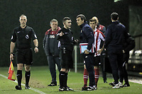 Pictured: Referee Savvas Yianni speaks to a Bilbao coach. Wednesday 20 December 2017<br /> Re: Premier League International Cup, Swansea City U23 v Athletic Bilbao at the Landore Training Ground, Swansea, Wales, UK.