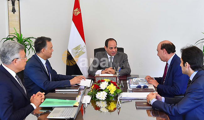 Egyptian President Abdel-Fattah al-Sisi meets with the Minister of Transport, the head of the Suez Canal Authority and the head of the Administrative Control Authority, in Cairo, Egypt, on july 2, 2018. Photo by Egyptian President Office