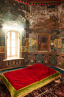 Surrounded by walls of intricate paintings and frescoes, the maharaja bed chamber in Kota's Old Royal Palace is one of the highlights of the Palace.