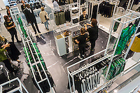 Shoppers in the designated Balmain x H&M section of an H&M store in New York on Thursday, November 5, 2015. The collection, designed by the young head of Balmain, Olivier Rousteing, was highly anticipated by fashionistas and drew crowds around the world. In New York H&M instituted a wristband system to time when shoppers could arrive to control crowds. (© Richard B. Levine)