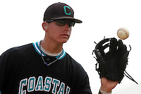 The Coastal Carolina University Chanticleers third baseman Scott Woodward #10 catching a throw during the 2nd and deciding game of the NCAA Super Regional vs. the University of South Carolina Gamecocks on June 13, 2010 at BB&T Coastal Field in Myrtle Beach, SC.  The Gamecocks defeated Coastal Carolina 10-9 to advance to the 2010 NCAA College World Series in Omaha, Nebraska. Photo By Robert Gurganus/Four Seam Images