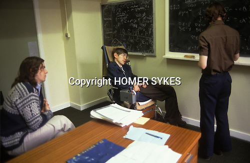 Stephen Hawking 1981 Cambridge University tutorial with students Nick Warner and Ian Moss.( at blackboard )  Nick Warner is Professor of Theoretical High Energy Physics at the University of Southern California USA. Ian Moss is now Professor of Theoretical Cosmology at the University of Newcastle UK