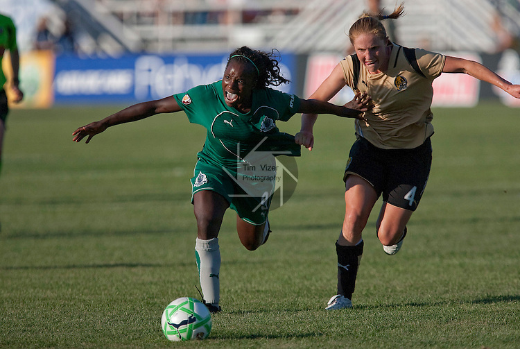 July 26 2009            Athletica's Eniola Aluko (9, left) yells out as she was restrained by her shirt by FC Gold Pride player Rachel Buehler (4, right) late in the second half.  Buehler got a foul on the play.  The game ended in a 1-1 tie.    The St. Louis Athletica hosted the FC Gold Pride on Sunday July 26, 2009 at the Anheuser Busch Soccer Park in Fenton, Missouri.   ..            *******EDITORIAL USE ONLY*******