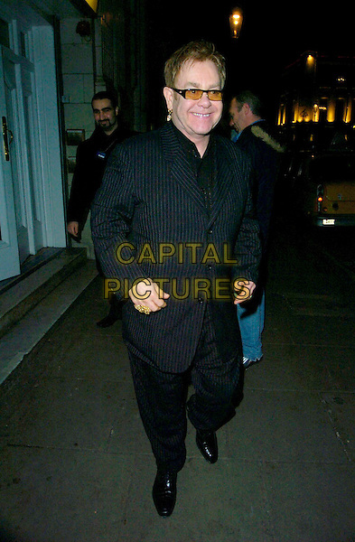 "ELTON JOHN.The ""A Guide To Recognizing Your Saints"" screening at The Electric Cinema, London, UK..March 1st, 2007.full length black pinstripe suit sunglasses shades .CAP/CAN.©Can Nguyen/Capital Pictures"