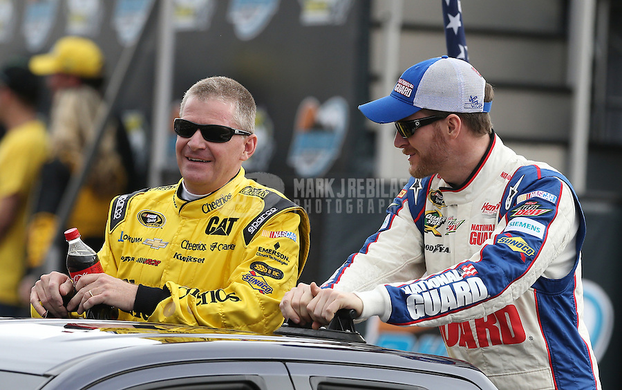 Mar. 3, 2013; Avondale, AZ, USA; NASCAR Sprint Cup Series driver Jeff Burton (left) with Dale Earnhardt Jr during the Subway Fresh Fit 500 at Phoenix International Raceway. Mandatory Credit: Mark J. Rebilas-