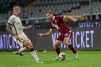 29th July 2020; Olympic Grande Torino Stadium, Turin, Piedmont, Italy; Serie A Football, Torino versus Roma; Gianluca Mancini of AS Roma takes on Cristian Ansaldi of Torino FC