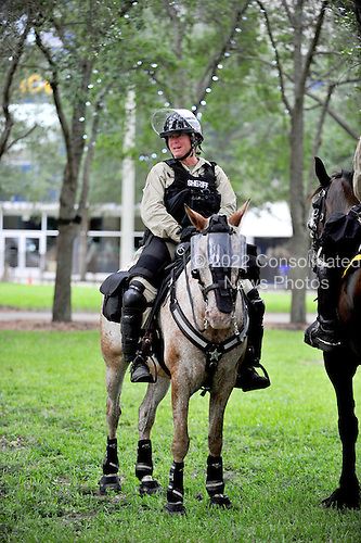 State Trooper on horseback patrols the park where protests are allowed near the 2012 Republican National Convention in Tampa Bay, Florida on Saturday, August 25, 2012..Credit: Ron Sachs / CNP.(RESTRICTION: NO New York or New Jersey Newspapers or newspapers within a 75 mile radius of New York City)