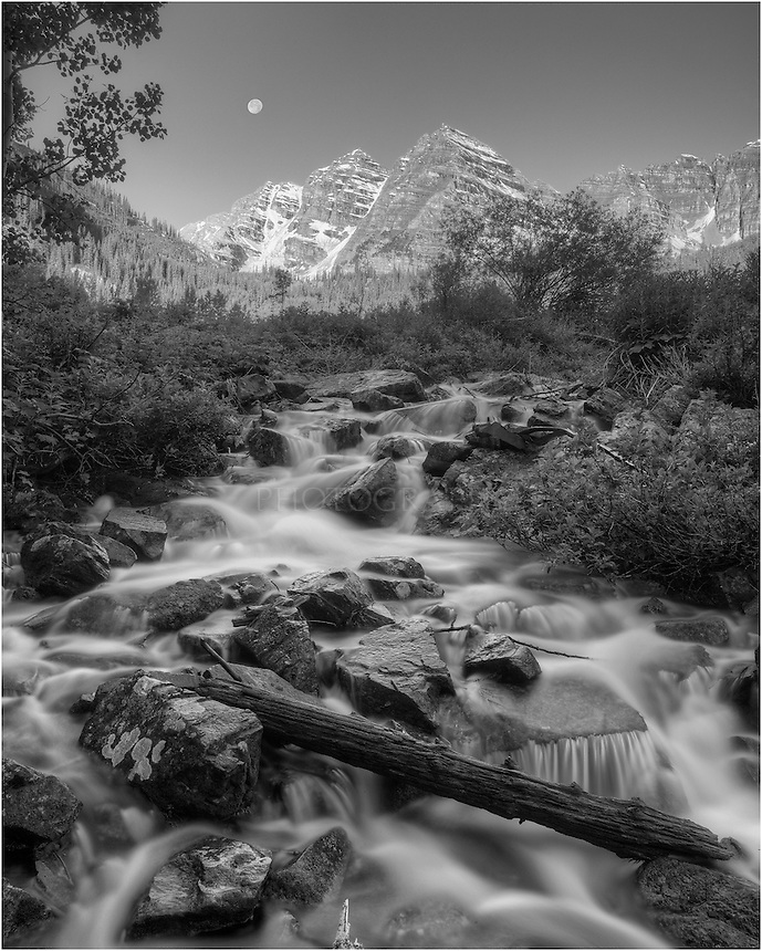 I had been photographing the Maroon Bells since ~ 3:00am this particular morning. This image of the Bells, near Aspen, Colorado, was taken before sunrise as the full moon set behind the Rocky Mountains.
