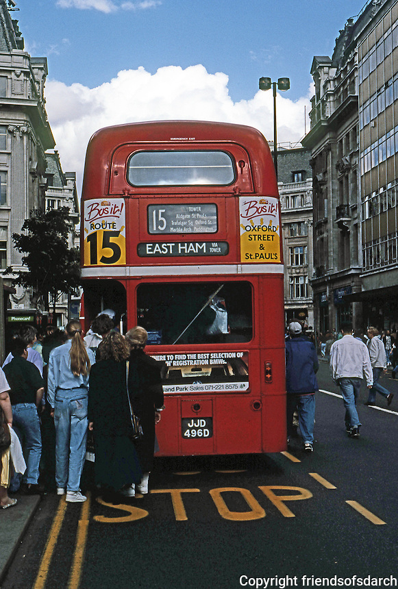 London: Eastbound bus, Oxford St. near Oxford Circus, 1990. The Board-at-the-Back Driver-Conductor being phased out. Driver to collect fares.