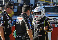 Feb. 14, 2013; Pomona, CA, USA; NHRA top fuel dragster driver Brittany Force (right) talks with crew members during qualifying for the Winternationals at Auto Club Raceway at Pomona.. Mandatory Credit: Mark J. Rebilas-