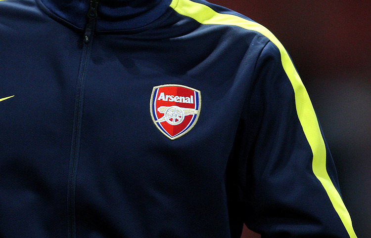 Arsenal logo shown on the tracksuit top of Arsenal's Andre Santos ..Football - UEFA Champions League Group B - Arsenal v Olympiakos FC - Wednesday 3rd October 2012 - Emirates Stadium - London..