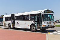 A route 13 bus waits to depart from Ocean Park in Oak Bluffs, Massachusetts headed for Edgartown on Martha's Vineyard.