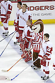 Jamie McBain 2, ?, Shane Connelly 35 and Ben Street 22 of the University of Wisconsin line up for the anthem with Bucky.  The Boston College Eagles defeated the University of Wisconsin Badgers 3-0 on Friday, October 27, 2006, at the Kohl Center in Madison, Wisconsin in their first meeting since the 2006 Frozen Four Final which Wisconsin won 2-1 to take the national championship.<br />