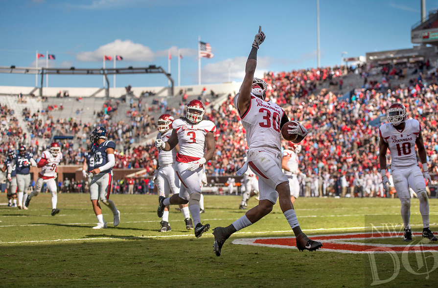 Hawgs Illustrated/BEN GOFF <br /> Kevin Richardson, Arkansas nickel back, runs for a touchdown after recovering an Ole Miss fumble in the fourth  quarter Saturday, Oct. 28, 2017, at Vaught-Hemingway Stadium in Oxford, Miss.