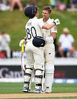 2nd December, Hamilton, New Zealand; England's Ollie Pope celebrates with Joe Root on Root's double century on day 4 of the 2nd test cricket match between New Zealand and England  at Seddon Park, Hamilton, New Zealand.