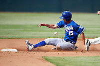 Kansas City Royals minor league outfielder Bubba Starling #15 slides into second on a stolen base during an instructional league game against the San Francisco Giants at the Giants Baseball Complex on October 18, 2012 in Scottsdale, Arizona. (Mike Janes/Four Seam Images)