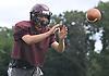 Ryan Aughavin, North Shore quarterback, takes a snap during varsity football team practice at North Shore High School in Glen Head on Thursday, Aug. 18, 2016.