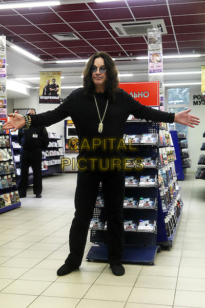 """Ozzy Osbourne.The autograph-session in shop """"Union"""", Moscow, Russia..September 12th, 2010.full length black trousers top hands arms sunglasses shades .CAP/PER/SB.©SB/PersonaStars/CapitalPictures"""