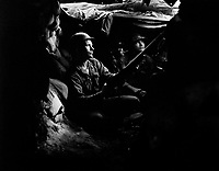 Infantrymen of the 27th Infantry Regiment, near Heartbreak Ridge, take advantage of cover and concealment in tunnel positions, 40 yards from the Communists.  August 10, 1952. Feldman. (Army)<br /> NARA FILE #:  111-SC-410716<br /> WAR &amp; CONFLICT BOOK #:  1427