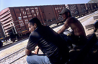 Inmigrants from Central America in Chiapas, Southern Mexico, before boarding a train in their attempt to reach the US border. They are the poorest persons among the inmigrants, they got to Mexico walking from Honduras, Guatemala or Nicaragua. Once in Mexico they can rest in shelters run by catholic priests before facing the dangerous train travel. In this step, they are often abused by police and gangs that steal the men and rape the women..Migrantes esperan la salida del tren en Arriaga, Chiapas, para continuar su viaje hacia la frontera norte de México.
