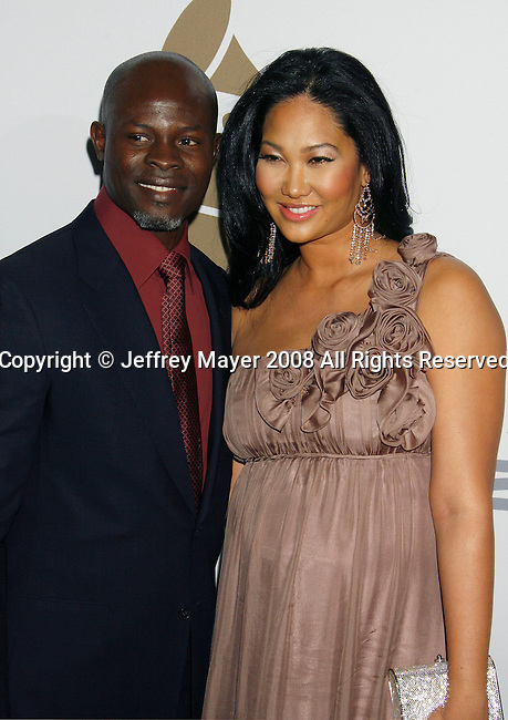 BEVERLY HILLS, CA. - February 07: Actor Djimon Hounsou (L) and designer Kimora Lee arrive at the 2009 GRAMMY Salute To Industry Icons honoring Clive Davis at the Beverly Hilton Hotel on February 7, 2009 in Beverly Hills, California.