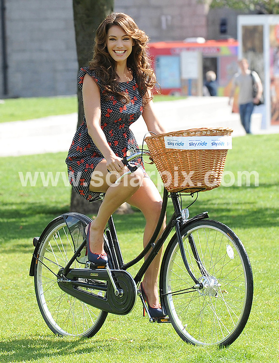 **ALL ROUND PICTURES FROM SOLARPIX.COM**.**WORLDWIDE SYNDICATION RIGHTS**.The Mayor of London, Boris Johnson is joined by Sky Ride ambassador Kelly Brook to launch the 15km ride through central London on September 5. Held at Potters Fields Park, London UK. 31 August 2010...This pic: Kelly Brook..JOB REF: 12014 SSD     DATE: 31_08_2010.**MUST CREDIT SOLARPIX.COM OR DOUBLE FEE WILL BE CHARGED**.**MUST NOTIFY SOLARPIX OF ONLINE USAGE**.**CALL US ON: +34 952 811 768 or LOW RATE FROM UK 0844 617 7637**