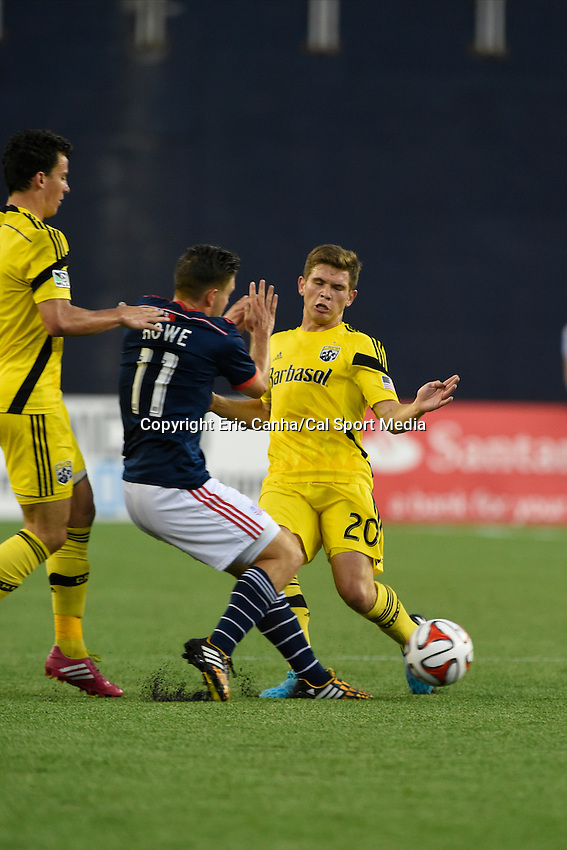 July 26, 2014 - Foxborough, Massachusetts, U.S. - New England Revolution midfielder Kelyn Rowe (11) and Columbus Crew midfielder Wil Trapp (20) prepare to collide as they work for the ball during the MLS game between the Columbus Crew and the New England Revolution held at Gillette Stadium in Foxborough Massachusetts.  Eric Canha/CSM