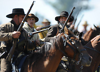 NWA Democrat-Gazette/ANDY SHUPE<br /> Members of the Confederate cavalry ride into battle Saturday, Sept. 26, 2015, during a re-enactment of the Civil War Battle of Pea Ridge in Pea Ridge. Visit nwadg.com/photos to see more photos from the weekend.
