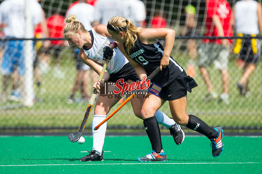 Madi Julius (10) of the Wake Forest Demon Deacons battles for the ball with Anna Brewer (19) of the Davidson Wildcats at Belk Turf Field on September 7, 2014 in Winston-Salem, North Carolina.  The Demon Deacons defeated the Wildcats 3-0.  (Brian Westerholt/Sports On Film)