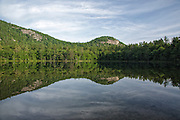 Reflection of cliff in Echo Lake from Echo Lake State Park in North Conway,  New Hampshire USA