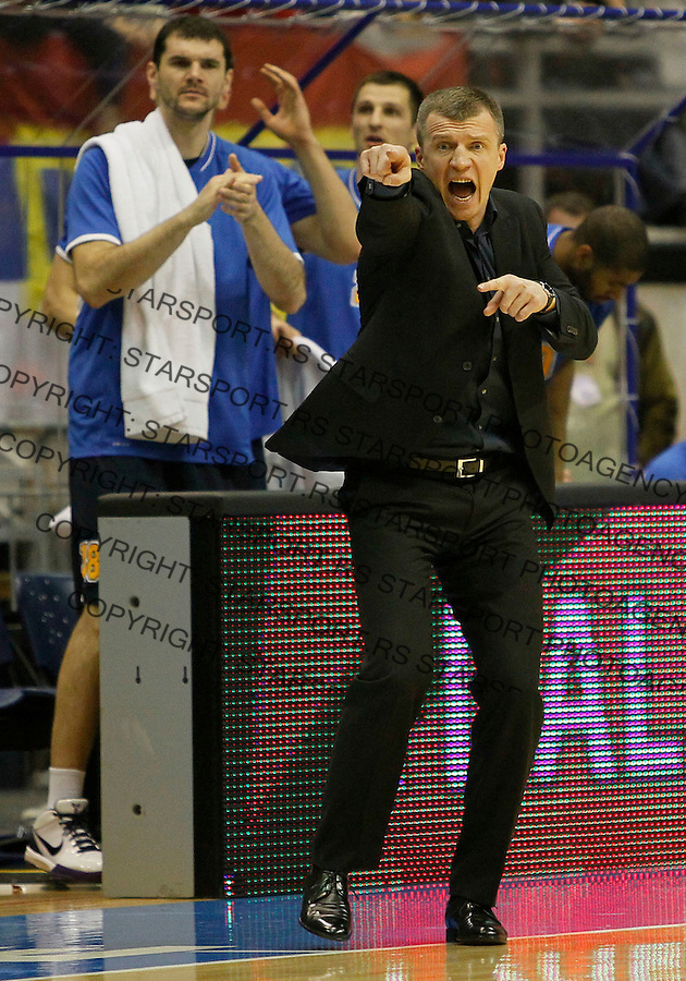 Poland's BC Asseco Prokom head coach Tomas Pacesas, center, during a Euroleague basketball match in Belgrade, Serbia, Wednesday, Dec. 15, 2010. (Srdjan Stevanovic/Starsportphoto.com)