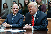 United States President Donald J. Trump congratulates NASA astronauts Jessica Meir and Christina Koch from the White House in Washington, DC after they conducted the first all-female spacewalk outside of the International Space Station on Friday, October 18, 2019.  at left is United States Vice President Mike Pence. <br /> Credit: Chris Kleponis / Pool via CNP