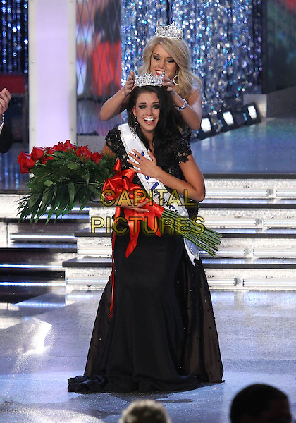 Miss America 2012 - Laura Kaeppeler.Miss Wisconsin Laura Kaeppeler is crowned as 2012 Miss America, Las Vegas, Nevada, USA, .14th January  2012..full length tiara crown flowers sash red   roses black dress crying .CAP/ADM/MJT.© MJT/AdMedia/Capital Pictures.