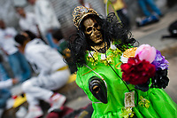 A figurine of Santa Muerte (Saint Death) is seen placed on the street during a religious pilgrimage in Tepito, a dangerous neighborhood of Mexico City, Mexico, 1 June 2011. The religious cult of Santa Muerte is a syncretic fusion of Aztec death worship rituals and Catholic beliefs. Born in lower-class neighborhoods of Mexico City, it has always been closely associated with crime. In the past decades, original Santa Muerte's followers (such as prostitutes, pickpockets and street drug traffickers) have merged with thousands of ordinary Mexican Catholics. The Saint Death veneration, offering a spiritual way out of hardship in the modern society, has rapidly expanded. Although the Catholic Church considers the Santa Muerte's followers as devil worshippers, on the first day of every month, crowds of believers in Saint Death fill the streets of Tepito. Holding skeletal figurines of Holy Death clothed in a long robe, they pray for power healing, protection and favors and make petitions to 'La Santísima Muerte', who reputedly can make life-saving miracles.