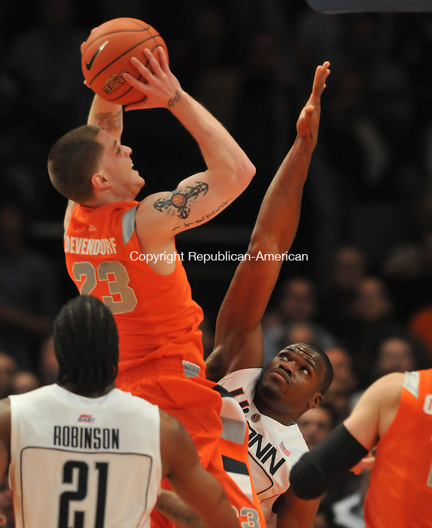 NEW YORK, NY--12 MARCH 2009-031209JS02--Syracuse's Eric Devendorf puts up a shot over UConn's Jeff Adrien during their Big East tournament game Thursday at Madison Square Garden in New York City.<br /> Jim Shannon Republican-American